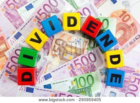 "Dividend concept. German word ""Dividende"" on european currency bills poster"