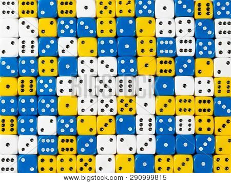 Pattern Background Of Random Ordered White, Blue And Yellow Dices