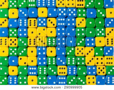Pattern Background Of Random Ordered Yellow, Green And Blue Dices