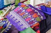 Traditional thai and Laos Sarong colorful on clothes line / woven silk shop poster