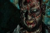 Close-up of a creepy scary zombie. Halloween. Horror film. poster
