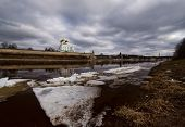 Ancient fortress on the river bank. Russia. Pskov Kremlin. Pskov spring time. ice drift poster