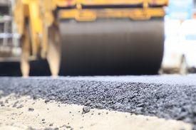 Road Construction Asphalt Road By Worker And Roller Machine. Asphalt Road Background