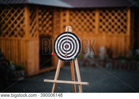 Target Dart With Arrow Over Blurred Bokeh Background, Metaphor To Target Marketing Concept. Target H