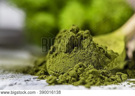 Green Powder Chlorella, Spirulina On Gray Concrete Background. Concept Dieting, Detox, Healthy Super