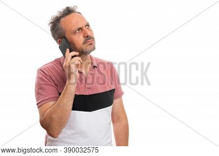 Adult Man Person Talking On Mobile Phone Thinking Making Serious Expression Looking At Blank Copyspa