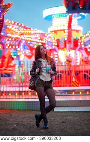Young woman in amusement park