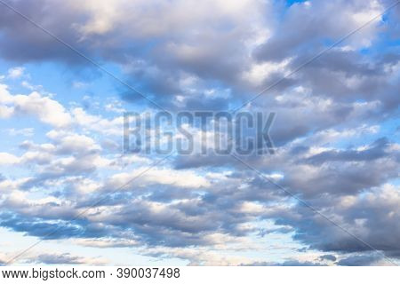 Many Gray And White Low Clouds In Blue Autumn Afternoon Sky
