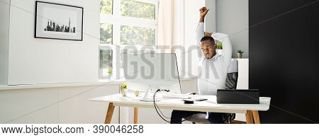 Office Stretch Exercise At Work. African American Man
