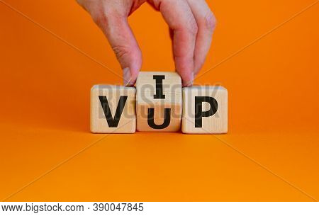 Hand Turns A Cube And Changes The Acronym 'vup' - Very Unimportant Person To 'vip' - Very Important