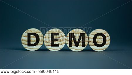 Wooden Small Circles With Letters 'demo' On A Beautiful Grey Background. Business Concept, Copy Spac