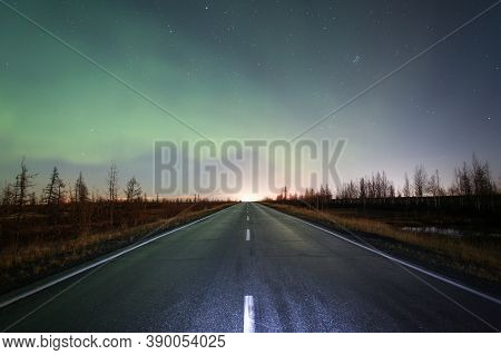 Northern Lights (aurora Borealis) Over The Road And The Dry Tundra