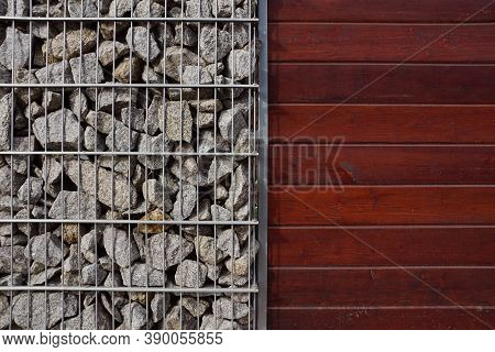 A Combination Of Baskets Filled With Granite Shards And Painted Boards. A Fragment Of A Fence Made O