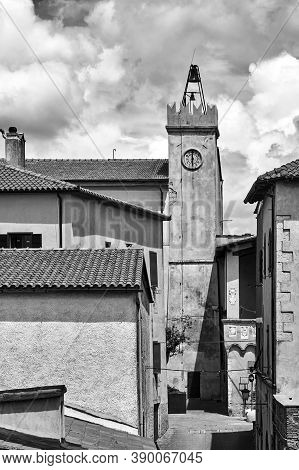 Historic Clock Tower In The City Of Magliano In Toscana, Italy, Monochrome