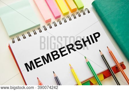 The Word Membership Is Written In A Notebook With Graphs Next To Pencils. Member Login Membership Lo