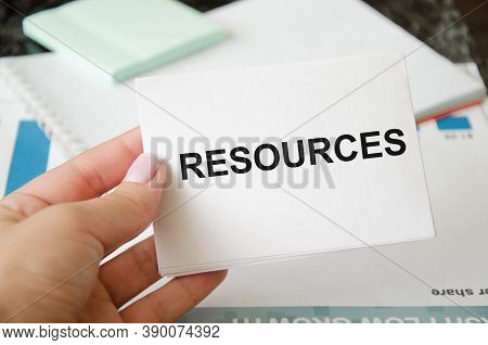 Businesswoman Holding A Sign With The Text Resources. Enterprise Resource Planning Concept. Business