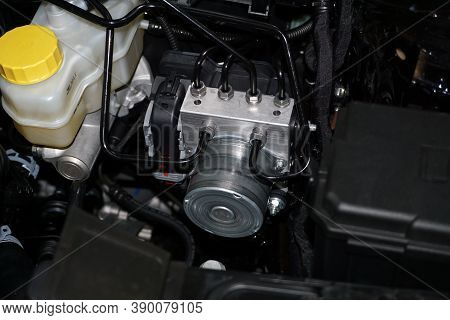 The Control Unit For The Anti-lock Braking System Abs Of A Modern Car Is Installed In The Engine Com