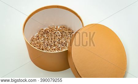 Bijouterie. Gold Chains In A Beautiful Golden Box On A White Background. Jewelry Concept