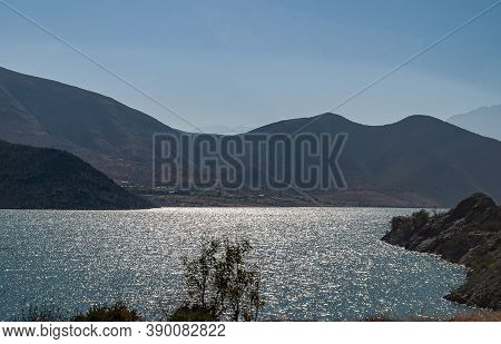 Vicuna, Chile - December 7, 2008: Landscape Of Brown Mountains And Light Reflecting And Playing On W