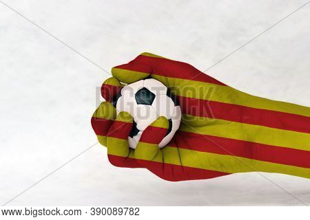 Mini Ball Of Football In Catalunya Flag Painted Hand On White Background. Concept Of Sport Or The Ga