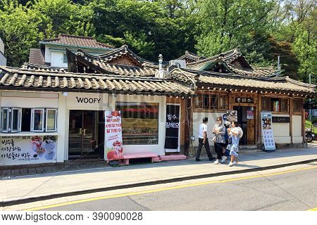 Seoul, South Korea - April 30, 2017: Bukchon Hanok Village - Korean traditional village is a historical place in a modern metropolis where Koreans still live in old traditional houses - hanok.