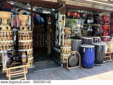 Seoul, South Korea - May 1, 2017: Korean traditional drums of different colors and sizes are on sale on the street in front of the music store. Korean drum shop in Seoul
