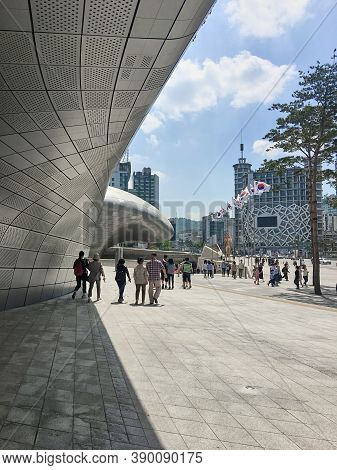 Seoul, South Korea - May 5, 2017: Dongdaemun Design Plaza (DDP) cultural and entertainment complex. Modern architectural landmark designed by Zaha Hadid. People walk around the DDP