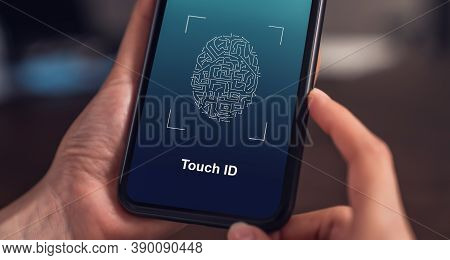 Close-up Of Hands Scanning Fingerprint On Smartphone To Unlock Mobile Phone On The Table, Concept Se
