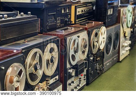 Set Of Old Reel Players And Tape Recorders, Retro Machines Background. Reel Tape Recorders.