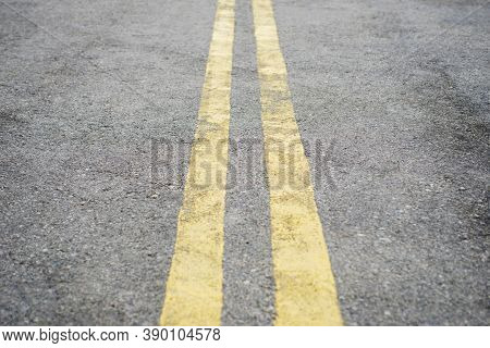 Yellow Double Solid Line. Road Markings On Asphalt On The Street. Highway Surface With Double Yellow