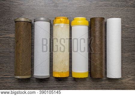 Old And New Filter Cartridges For Water. New And Used Blocks Filters For Cleaning Water In Equipment