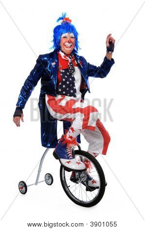 Clown Riding Unicycle With Training Wheels