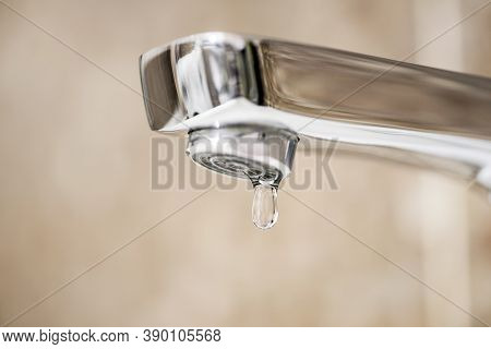 Faucet With Dripping Water. Tap Closeup With Dripping Water-drop. Water Leaking, Saving Concept