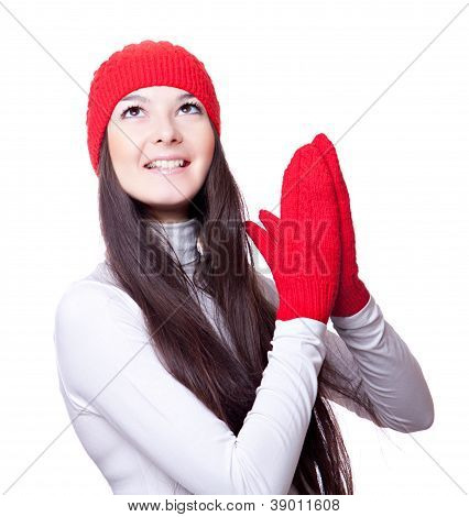 woman in  red cap and mittens rejoices