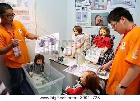 SUBANG JAYA - NOV 10:Unidentified students from Japan shows a robotic system that checks health status of person living alone at the World Robot Olympaid on November 10, 2012 in Subang Jaya, Malaysia.