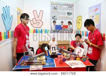 SUBANG JAYA - NOV 10: Unidentified students from Hong Kong build a robot that allow people to play a hand game by remote at the World Robot Olympaid on November 10, 2012 in Subang Jaya, Malaysia.
