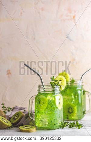 Glass Jar Of Kiwi Juice Or Smoothie. Kiwi Mojito Cocktail Or Non-alcohol Mocktail With Mint And Slic