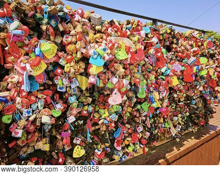 Seoul, South Korea - April 29, 2017:  Many Heart-shaped Locks Form A Colorful Pattern. Fastening Loc
