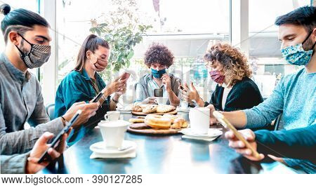 Millenial People Using Mobile Smart Phones At Coffee Bar - New Normal Lifestyle Concept With Friends