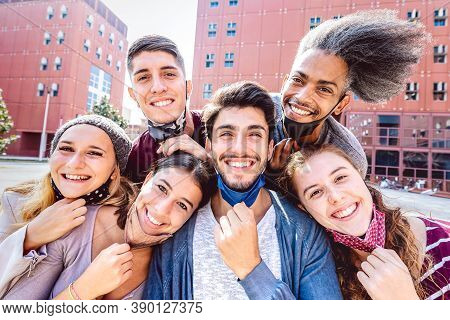 Multiracial Friends Taking Selfie With Opened Face Mask At College Campus - Happy Friendship Concept