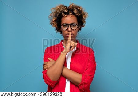 Pretty African Woman Makes Shush, Asks Not Be Loud, Has Secret Expression, Presses Index Finger Over