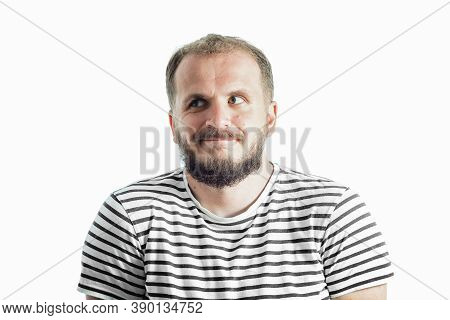 Perplexity Bearded Man In A Striped T-shirt Looking Away. 30-35 Years Old. Isolated On White.