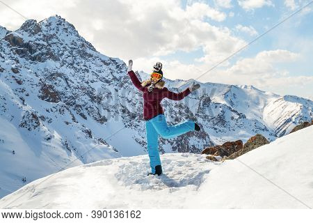 Beautiful Happy Young Woman On Top Of The Mountain
