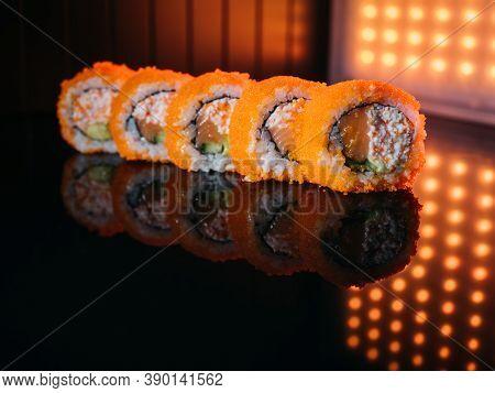 Sushi Uramaki Rolls With Orange Tobiko Caviar
