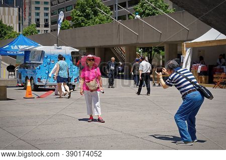 Toronto, Canada - 06 27 2016: A Tourists Couple Taking A Photo In The Main Square Of Toronto Nathan