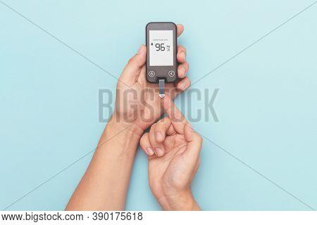 Man Using Glucometer, Checking Blood Sugar Level. Diabetes Concept