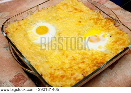 Above Close-up View Of Home Cooking With Focus On Fried Eggs In Home Cooking Platter