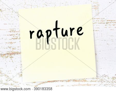 Concept Of Reminder About Rapture. Yellow Sticky Sheet Of Paper On Wooden Wall With Inscription