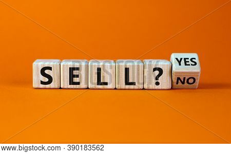 Time To Sell. Turned A Cube And Changed The Words 'sell No' To 'sell Yes'. Beautiful Orange Backgrou