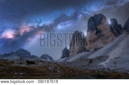 Milky Way Over Mountains At Night In Summer. Beautiful Landscape With Alpine Mountains, Blue Sky Wit